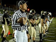 13 Nov. 2009 -- ST. LOUIS -- Game officials and Oakville captains gather along the sidelines just prior to the coin toss to open the MSHSAA playoff football game between Oakville and Fox Friday, Nov. 13, 2009. Oakville led the game 30-10 at halftime. Photo © copyright 2009 by Sid Hastings.