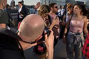 Photographer Michael Kemp on London Bridge, on 19th April 2018, in London, England.