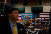 U.S. Democratic presidential nominee Hillary Clinton listens to Colorado Governor John Hickenlooper (L) at a rally in Commerce City, Colorado August 3, 2016. REUTERS/Rick Wilking