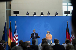 59860286    <br /> Barack Obama, president of the USA, and German Chancellor Angela Merkel (right) during a press call at a state visit of the Chancellery in Berlin, Germany. Barack Obama will walk in John F. Kennedy's footsteps this week on his first visit to Berlin as US president, but encounter a more powerful and sceptical Germany in talks on trade and secret surveillance practices. International Politics, Berlin, Germany on Wednesday 19 June, 2013. UK ONLY
