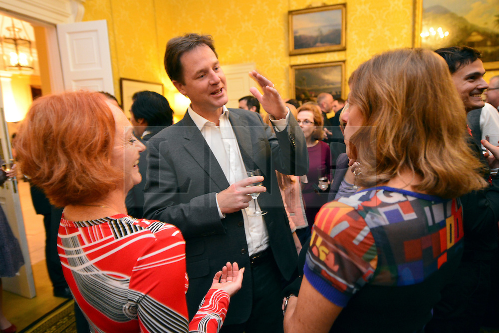 © Licensed to London News Pictures. 11/09/2013. London, UK The Deputy Prime Minister, Nick Clegg (centre), hosts a reception at Admiralty House in Whitehall this evening, 11 September 2013, to celebrate the government's progress in equal marriage. From next year gay people will be able to get married. A number of high profile guests including openly supportive celebrities, campaigners, religious figures and charities were in attendance.<br /> The London Gay Men Chorus Ensemble performed at the event. . Photo credit : Stephen Simpson/LNP