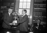 06/05/1965<br /> 05/06/1965<br /> 06 May 1965<br /> Presentation of the Read Cup for quality Butter production at the RDS, Ballsbridge, Dublin. Image shows Mr Charles Haughey, (centre) Minister for Agriculture presenting the Read Cup to Mr John Henigan (Cork), Chairman Dairy Disposal Co. creamery. Seated right is Mr Michael O'Leary, Manager of the Dairy Disposal Company creamery at Castletownbere, Co. Cork.