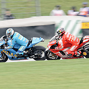 August 8, 2009, Mika Kallio prepares to pass Loris Capirossi during Free Practice 1 at the Red Bull Indianapolis Grand Prix.