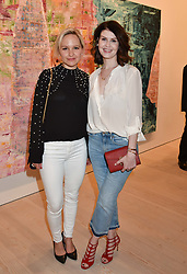 Left to right, Kim Pearson and Renee Lapino at a preview of an exhibition of art by Sassan Behnam-Bakhtiar entitled 'Oneness Wholeness' held at the Saatchi Gallery, Duke of York's HQ, King's Rd, London, England. 14 May 2018.