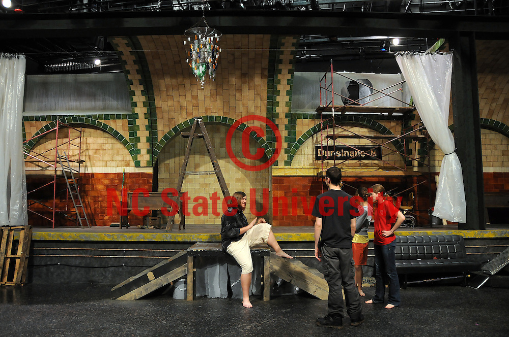"""Student actors wait to rehearse a scene from """"Hamlet"""" in Thompson Theatre."""