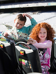 Repro Free: 03/03/2014 Kyle Burkem, (6) from Donaghmede and Alisha Burke (6) from Artane, find themselves on top of a bus in the middle of Croke Park as they help launch of the new City Sightseeing bus route at Croke Park stadium which now encompasses the Botanic Gardens, Glasnevin Cemetery and Croke Park.<br /> <br /> The new route will be open to the public from March 10th 2014 and extends the existing tour route. This &lsquo;true blue&rsquo; route will take visitors on a journey that gives an insight into the struggles and victories that shaped this country encapsulating social, cultural and sporting history, amazing views and landscapes from three of Dublin&rsquo;s top 10 attractions (Tripadvisor). In this decade of commemorations, these sites are at the forefront in remembering and commemorating great events and people in Irish history. Picture Andres Poveda