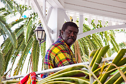 A man looks over as the band plays traditional Calypso music.