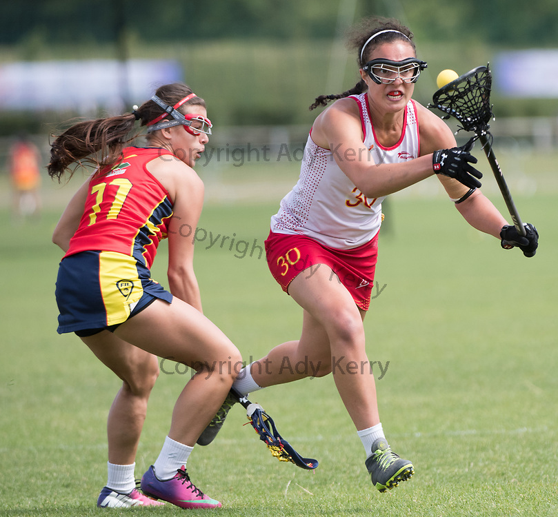 Spain's Selena Hunter(30) skips past Colombia's Maira Florián Hernández(11) at the 2017 FIL Rathbones Women's Lacrosse World Cup at Surrey Sports Park, Guilford, Surrey, UK, 15th July 2017
