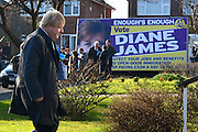 © Licensed to London News Pictures. 20/02/2013. Eastleigh, UK Boris Johnson approaches a property whilst a UKIP advertising hoarding parks in the street.  London Mayor and member of the Conservative Party, Boris Johnson, and Conservative Candidate Maria Hutchins campaigning in the Eastleigh By-Election today 20th February in Stamford way, Eastleigh. Photo credit : Stephen Simpson/LNP