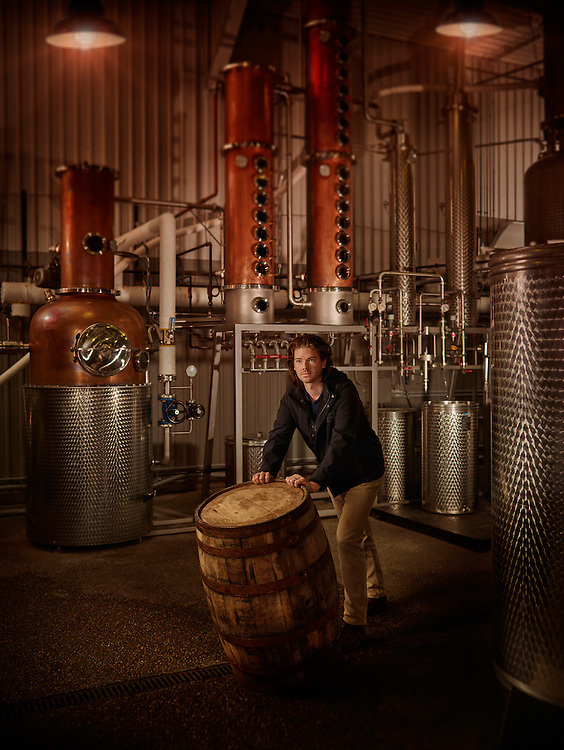 Add Owner of Dillon's Distillery moving Barrels through the Distillery Shot on a PhaseOne IQ180 as a Environmental Portrait.