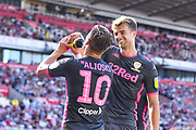 Leeds United forward Patrick Bamford (9) scores a goal and celebrates with Leeds United defender Ezgjan Alioski (10) to make the score 0-3 during the EFL Sky Bet Championship match between Stoke City and Leeds United at the Bet365 Stadium, Stoke-on-Trent, England on 24 August 2019.