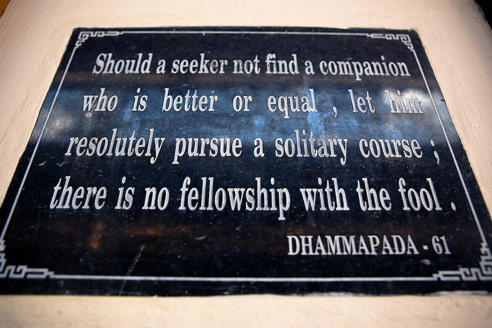 "Sign inside Long Son Pagoda, near Nha Trang, quoting from the book of Buddha's teachings :  ""Should a seeker not find a companion who is better or equal, let him resolutely pursue a solitary course; there is no fellowship with the fool.""  Dhammapada 61."