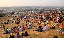 © London news Pictures. 21/06/2017. Glastonbury, UK. The sun sets on revellers enjoying day one of the 2017 Glastonbury Festival. The five-day festival of contemporary performing arts is the highlight of the British festival season. Photo credit: Jason Bryant/LNP