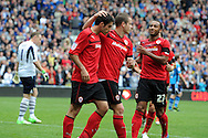 Cardiff city's Peter Whittingham (l) celebrates his goal with teammates Heidar Helguson © and Nicky Maynard (r). NPower championship, Cardiff city v Leeds United at the Cardiff city stadium in Cardiff, South Wales on Sat 15th Sept 2012.   pic by  Andrew Orchard, Andrew Orchard sports photography,