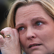 Carrie Kassman, daughter of the late Randy Hockabout wipes away tears as she watches balloons float away during a ceremony to remember his life at Optimist Park, where his body was found on January 25, 1986. The homicide has remained unsolved and Hockabout's family have launched new efforts to solve the crime including using facebook to find leads. (Jason A. Frizzelle)