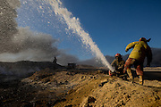 Firefighters from the city of Kirkuk, Iraq who specialize in the disposal of oil field fires have been fighting The Qayyara fires for months. They claim that it will take many months more. Qayyara, Iraq. Nov. 23, 2016. (Photo by Gabriel Romero ©2016)