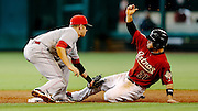 June 3, 2012; Houston, TX, USA; Cincinnati Reds shortstop Zack Cozart (2) tags out Houston Astros second baseman Jose Altuve (27) on a steal attempt during the third inning at Minute Maid Park. Mandatory Credit: Thomas Campbell-US PRESSWIRE
