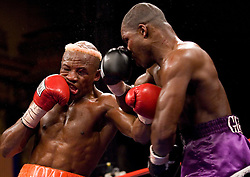 April 11, 2007; Bronx, NY, USA;  Willie Gibbs (black trunks) and Raymond Joval (white trunks) trade punches during their 10 round junior middleweight bout at the Paradise Theater.