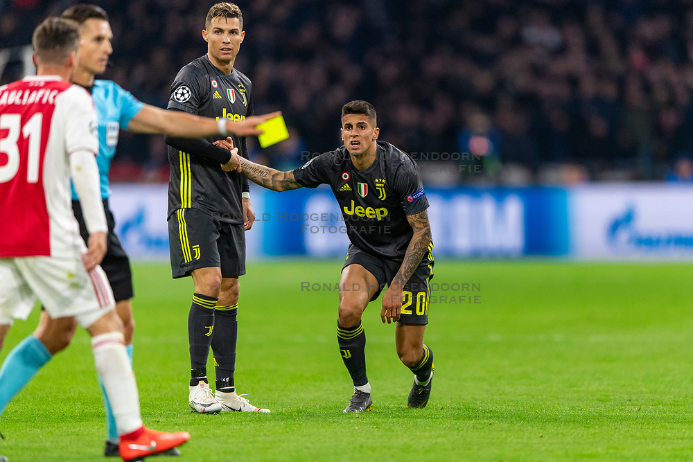 10-04-2019 NED: Champions League AFC Ajax - Juventus,  Amsterdam<br /> Round of 8, 1st leg / Ajax plays the first match 1-1 against Juventus during the UEFA Champions League first leg quarter-final football match / Joao Cancelo #20 of Juventus, Cristiano Ronaldo #7 of Juventus