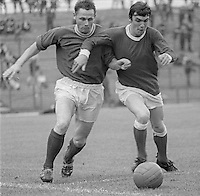 Ken Gilliland, Linfield FC, Belfast, left, and Roan Hannah, Portadown FC, N Ireland, fight for possession during a match at Windsor Park, N Ireland, November, 1969, 197011000011<br />