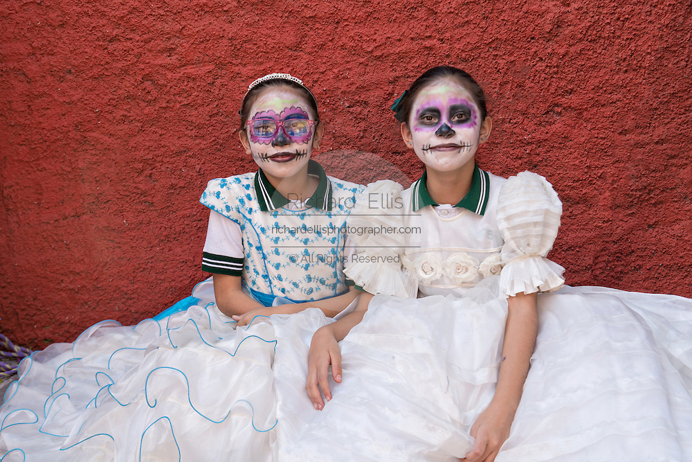 Young girls dressed as La Calavera Catrina at the Nuestra Señora de Guadalupe cemetery during the Day of the Dead festival November 1, 2016 in San Miguel de Allende, Guanajuato, Mexico. The week-long celebration is a time when Mexicans welcome the dead back to earth for a visit and celebrate life.