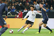 Leroy Sane of Germany and Michael Keane of England battle during the International Friendly match between Germany and England at Signal Iduna Park, Dortmund, Germany on 22 March 2017. Photo by Phil Duncan.