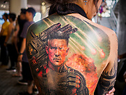 28 OCTOBER 2018 - BANGKOK, THAILAND: The back of a tattooed woman at the 2018 MBK Center Tattoo Fest. Tatoo artists from around the world came to participate in the festival, which featured both modern (using tattoo machines) and traditional methods (done by hand with long needles) of tattooing.  PHOTO BY JACK KURTZ