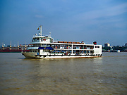 20 NOVEMBER 2017 - YANGON, MYANMAR: The Dala Ferry comes into Dala from Yangon. Tens of thousands of commuters ride the ferry every day. It brings workers into Yangon from Dala, a working class community across the river from Yangon. A bridge is being built across the river, downstream from the ferry to make it easier for commuters to get into the city.     PHOTO BY JACK KURTZ