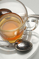 Glass of tea and strainers, close-up