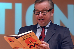 "© Licensed to London News Pictures. 17/11/2012. London, UK Michael Gove reads aloud from the book ""The Lost World of British Communism"" Education Secretary Michael Gove (right) in conversation with journalist David Aaronovitch at the London Festival of Education today, 17th November 2012. Mr Gove took part in a lively question and answer session and was booed by some of the audience on arrival to stage. Photo credit : Stephen Simpson/LNP"