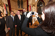 Vienna, Austria. Cocktail reception hosted by Mayor Michael Häupl at City Hall for international scientists and researchers living and working in Vienna.<br /> Three young people from Italy taking souvenir photos with Michael Häupl, Mayor of Vienna.
