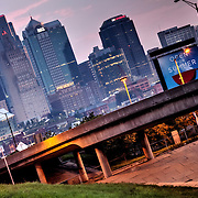 Kansas City MO skyline from West Side area near I-35 at sunrise, August 2013.