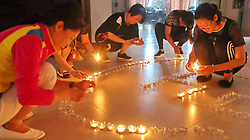 June 27, 2017 - Qinhuangdao, Qinhuangdao, China - Qinhuangdao, CHINA-June 27 2017: (EDITORIAL USE ONLY. CHINA OUT)..People pray for victims of the landslide in Miaoxian at a residential community district in Qinhuangdao, north China's Hebei Province, June 27th, 2017. A devastating landslide occurred in Maoxian County, southwest China's Sichuan Province, June 24th,2017, leaving many people missing. (Credit Image: © SIPA Asia via ZUMA Wire)