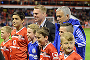 Chelsea Manager Jose Mourinho and Wasall Manager Dean Smith with mascots during the Capital One Cup match between Walsall and Chelsea at the Banks's Stadium, Walsall, England on 23 September 2015. Photo by Alan Franklin.