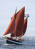 "The Spirit of Mystery sailing. Plymouth Sound and Rame Head. Cornwall. UK..Pictures shows Pete Goss onboard  his new Cornish Lugger ""Spirit of Mystery"". Pete and a crew made up from family: Eliot Goss (Pete Goss' son).Andy Goss (Pete Goss'  brother).Mark Maidment (Pete Goss'  brother in-law) are due to set sail later this year to recreate the original voyage of the Mystery to Melbourne. Australia via Cape Town. South Africa Please credit all pictures ""Lloyd Images"""