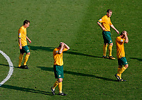 Photo: Glyn Thomas.<br />Italy v Australia. 2nd Round, FIFA World Cup 2006. 26/06/2006.<br /> Australian players are dejected after losing 1-0 to a last-minute penalty from Francesco Totti.