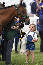 Mia Tindall helps Princess Anne give out rosettes for the RDA on the third day of The Magic Millions Festival of British Eventing at Gatcombe Park, Minchinhampton, Gloucestershire, UK, on the 4th August 2019. 04 Aug 2019 Pictured: Mia Tindall helps Princess Anne give out rosettes for the RDA on the third day of The Magic Millions Festival of British Eventing at Gatcombe Park, Minchinhampton, Gloucestershire, UK, on the 4th August 2019. Photo credit: James Whatling / MEGA TheMegaAgency.com +1 888 505 6342