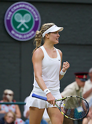 LONDON, ENGLAND - Monday, June 30, 2014: Eugenie Bouchard (CAN) celebrates after winning the Ladies' Singles 4th Round match 7-6 (5), 7-5 on day seven of the Wimbledon Lawn Tennis Championships at the All England Lawn Tennis and Croquet Club. (Pic by David Rawcliffe/Propaganda)