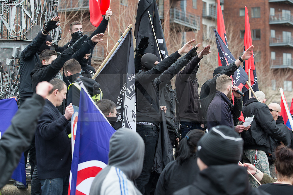 """© Licensed to London News Pictures . 21/03/2015 . Newcastle , UK . The crowd perform Nazi salutes . Neo-Nazis and skinheads from across Europe organise a """" White Man March """" in Newcastle , under the banner of """" National Action """" . Photo credit : Joel Goodman/LNP"""