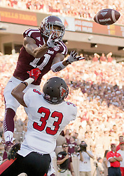Texas A&M's Josh Reynolds catches a pass for a touchdown against Ball State's Tyree Holder during the first quarter of a game at Kyle Field on Saturday.