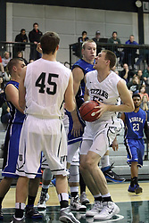 16 November 2013:  Nick Anderson looks for the hoop from beneath during an NCAA mens division 3 basketball game between the Aurora University Spartans and the Illinois Wesleyan Titans in Shirk Center, Bloomington IL