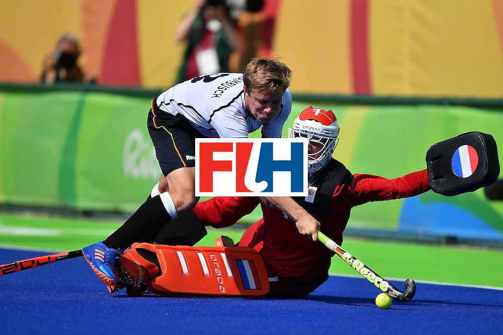 RIO DE JANEIRO, BRAZIL - AUGUST 18:  Goalkeeper of Netherlands Jaap Stockmann tries to save the shot from Timm Herzbruch of Germany during the penalty shoot out of the Mens's Bronze medal match between the Netherlands and Germany on Day 13 of the Rio 2016 Olympic games at Olympic Hockey Center on August 18, 2016 in Rio de Janeiro, Brazil.  (Photo by Pascal Le Segretain/Getty Images)