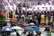 © Licensed to London News Pictures. 21/06/2012. Ascot, UK Raind didn't stop people from sitting outside. Ladies Day at Royal Ascot 21st June 2012. Royal Ascot has established itself as a national institution and the centrepiece of the British social calendar as well as being a stage for the best racehorses in the world.. Photo credit : Stephen Simpson/LNP