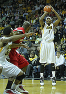 January 04 2010: Iowa Hawkeyes forward Melsahn Basabe (1) puts up a shot as Ohio State Buckeyes forward Dallas Lauderdale (52) and Iowa Hawkeyes forward Jarryd Cole (50) look on during the first half of an NCAA college basketball game at Carver-Hawkeye Arena in Iowa City, Iowa on January 04, 2010. Ohio State defeated Iowa 73-68.