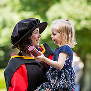 "25.08.2016          <br />  Faculty of Business, Kemmy Business School graduations at the University of Limerick today. <br /> <br /> Sharing at a moment at the conferring were, Phd graduate, Dr. Leonie McMeel Lynch and her 3 year old daughter Beau Milly Lynch, Ballysheedy, Limerick. Picture: Alan Place.<br /> <br /> <br /> As the University of Limerick commences four days of conferring ceremonies which will see 2568 students graduate, including 50 PhD graduates, UL President, Professor Don Barry highlighted the continued demand for UL graduates by employers; ""Traditionally UL's Graduate Employment figures trend well above the national average. Despite the challenging environment, UL's graduate employment rate for 2015 primary degree-holders is now 14% higher than the HEA's most recently-available national average figure which is 58% for 2014"". The survey of UL's 2015 graduates showed that 92% are either employed or pursuing further study."" Picture: Alan Place"