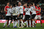 Both sets of players come together following a hard challenge on Derby County forward Jack Marriott  during the EFL Sky Bet Championship match between Derby County and Middlesbrough at the Pride Park, Derby, England on 1 January 2019.