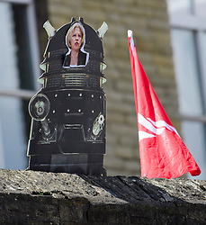 © Licensed to London News Pictures. 18/05/2017. Halifax, UK.  A photograph of British prime minister THERESA MAY attached to a picture of a darker, held up a demonstrators at the launch event for the Conservative Party manifesto at The Arches in Halifax, West Yorkshire. The Conservatives are the last of the three main parties to launch their manifesto ahead of a snap general election called for June 8, 2017. Photo credit: Ben Cawthra/LNP