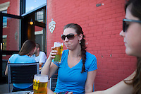 Kelly Lebeau (L) of Spencer and  Robin Potestio of Worcester, drink a beer on the patio of the tap room at Wormtown Brewery in Worcester, Massachusetts on August 28, 2015.  Matthew Healey for The Boston Globe<br /> <br /> (MAGAZINE Story Editor Francis Storrs, Assigning editor Jim Wilson, Visuals editor Lloyd Young)