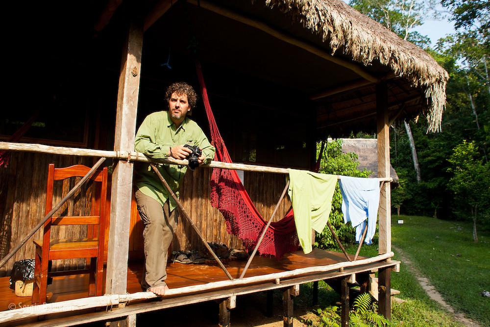 Corey Hendricskon dries his ExOfficio shirts at his cabin at Chalalan Lodge in Madidi NP in Bolivia.