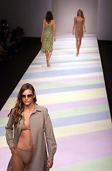 Ronit Zilkha Spring/Summer 2001 London Fashion Week.Model wears coat with bikini and sunglasses..Photo by Andrew Parsons/i-Images.All Rights Reserved ©Andrew Parsons/i-images.See Instructions.